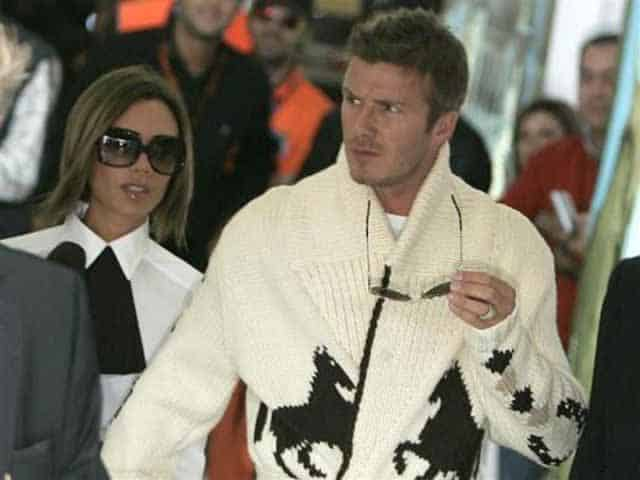 airport fashion - David & Victoria Beckham